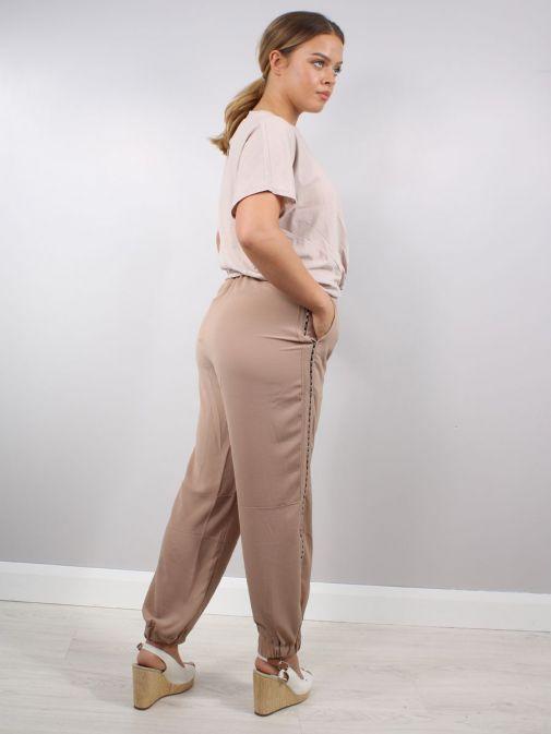 Back shot of Model wearing Religion Outlook Trousers in Beige