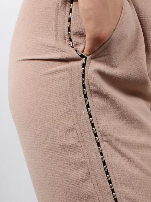 Close up shot of Model wearing Religion Outlook Trousers in Beige