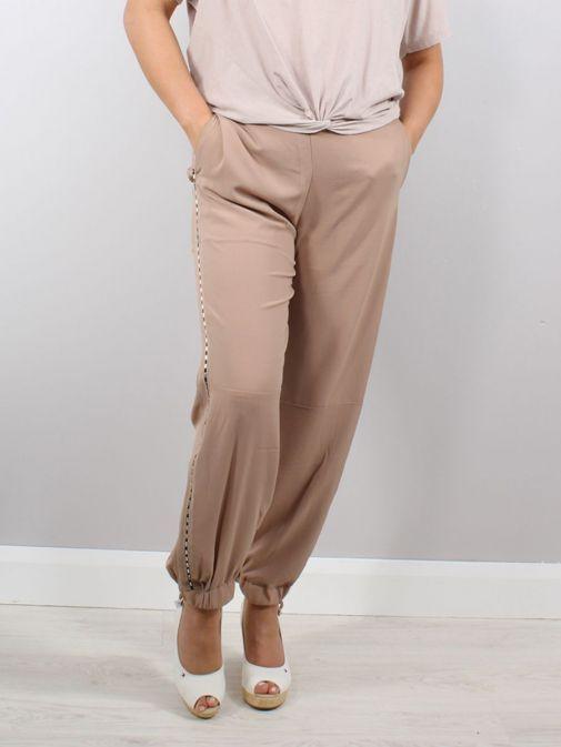 Model wearing Religion Outlook Trousers in Beige