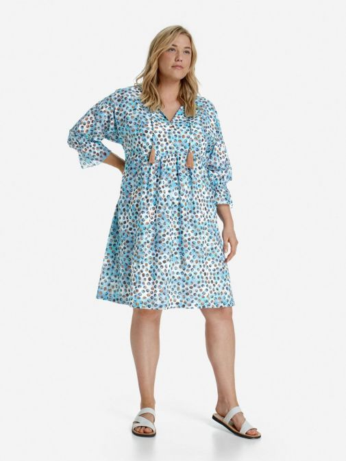 Front shot of the Samoon Shirt Dress in the Blue colour featuring 3/4 length sleeves, decorative tassels, v-neckline and printed detail
