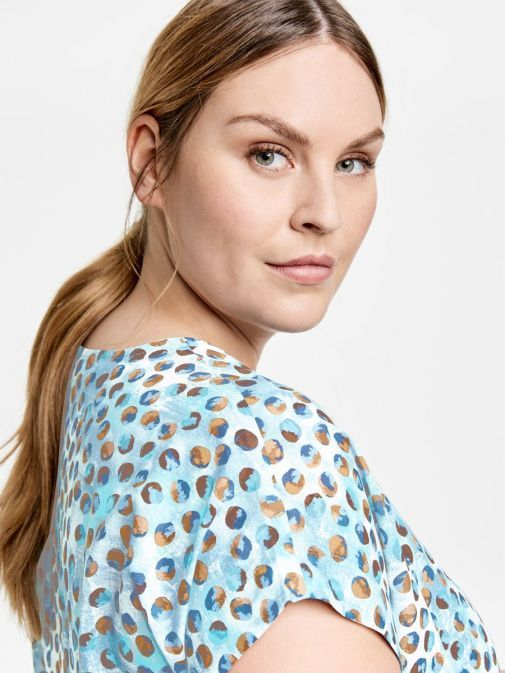 side shot of the Samoon Short Sleeve Top in the Blue colour featuring a rounded neckline, short sleeves and printed detail