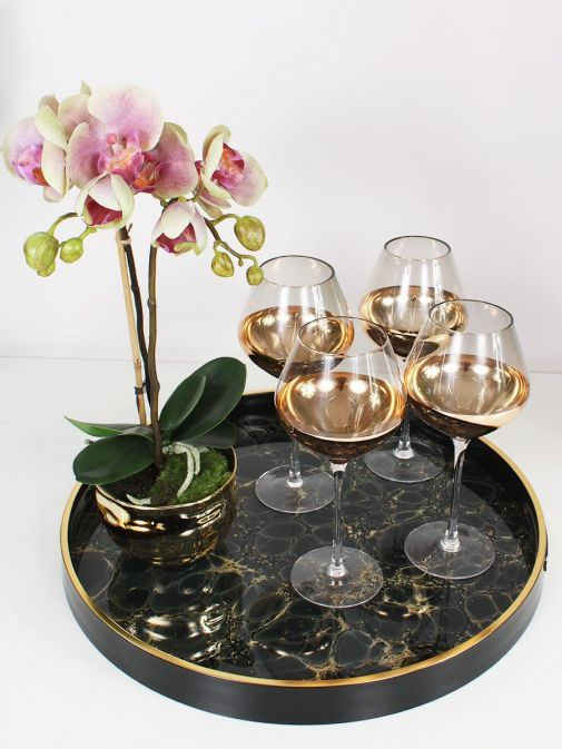high shot of the Set of 4 Smoke Wine Glasses on tray with plant