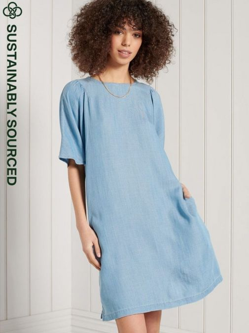 Front shot of the Superdry Tencel T-Shirt Dress in the Blue colour featuring pockets, rounded neckline and short sleeves