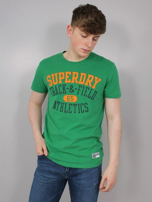 Front shot of the Superdry Track and Field Graphic T-Shirt  in  the Green featuring short sleeves, rounded neckline and printed across the front