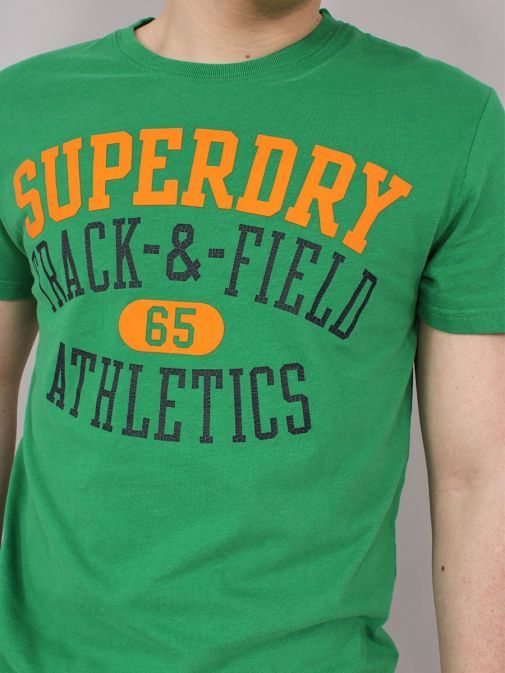 closeup of the Superdry Track and Field Graphic T-Shirt  in  the Green featuring short sleeves, rounded neckline and printed across the front