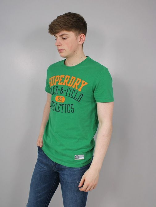 side shot of the Superdry Track and Field Graphic T-Shirt  in  the Green featuring short sleeves, rounded neckline and printed across the front