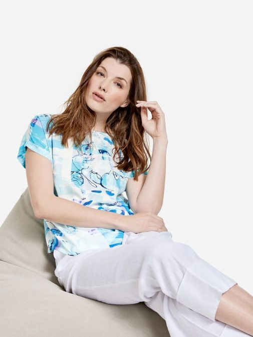 full outfit shot of the Taifun Printed Top in the Blue colour featuring cap sleeves with turn up's and rounded neckline