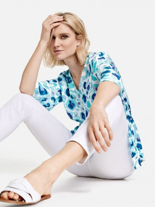 full outfit shot of the Taifun Printed Top in the Blue colour featuring v-neckline, 3/4 length sleeves, waist pull cord