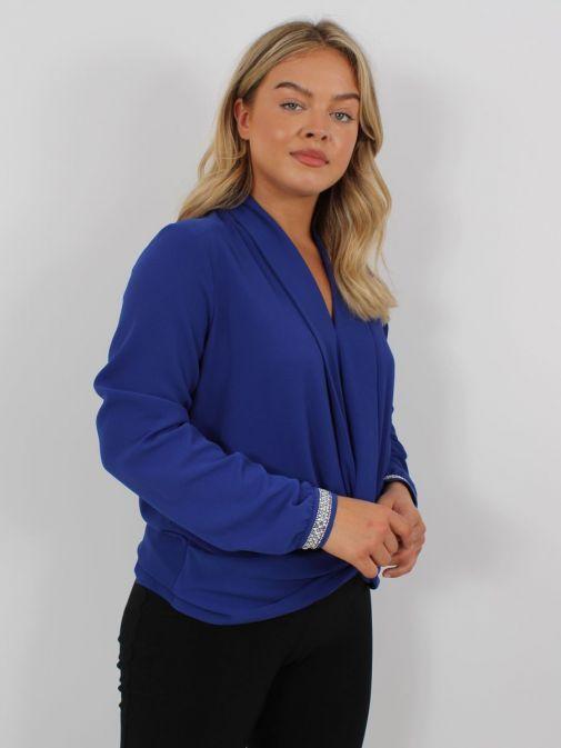 Side shot of Model wearing Tia Knot Effect Blouse in Blue