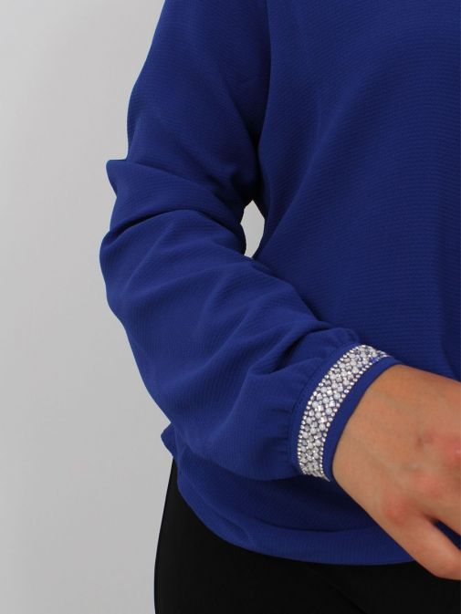 Close up of sleeve of Tia Knot Effect Blouse in Blue