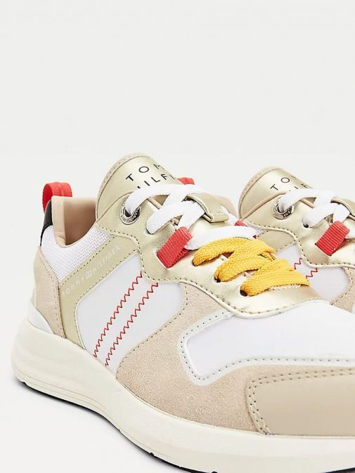 Close up image of Tommy Hilfiger Retro Mixed Texture Metallic Trainers in Beige
