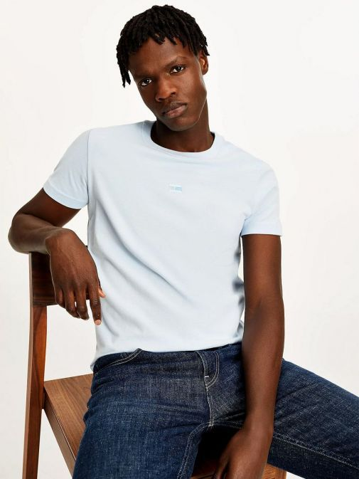 Model wearing Tommy Hilfiger Tonal Flag Embroidery T-Shirt in Sweet Blue
