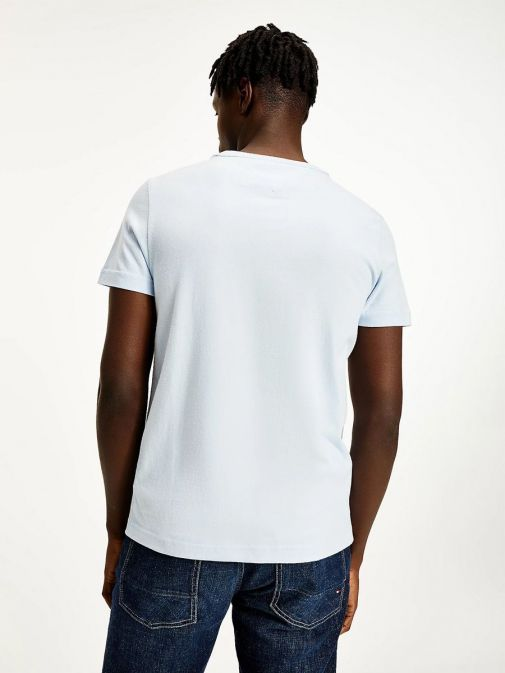 shot of back of model wearing Tommy Hilfiger Tonal Flag Embroidery T-Shirt in Sweet Blue
