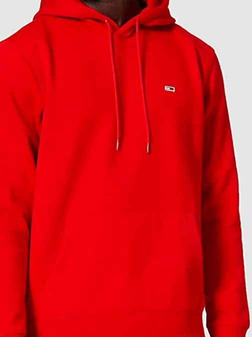 Close up image of model wearing Tommy Jeans Fleece Organic Hoody in Red