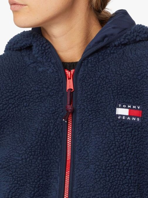 Close up of Tommy Jeans Tommy Badge Sherpa Hooded Jacket in Navy