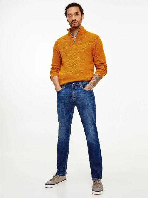 Full-length of Model wearing Tommy Hilfiger Denton Straight TH Flex Jeans in Kima Indigo