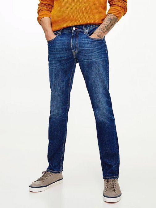 Model wearing Tommy Hilfiger Denton Straight TH Flex Jeans in Kima Indigo