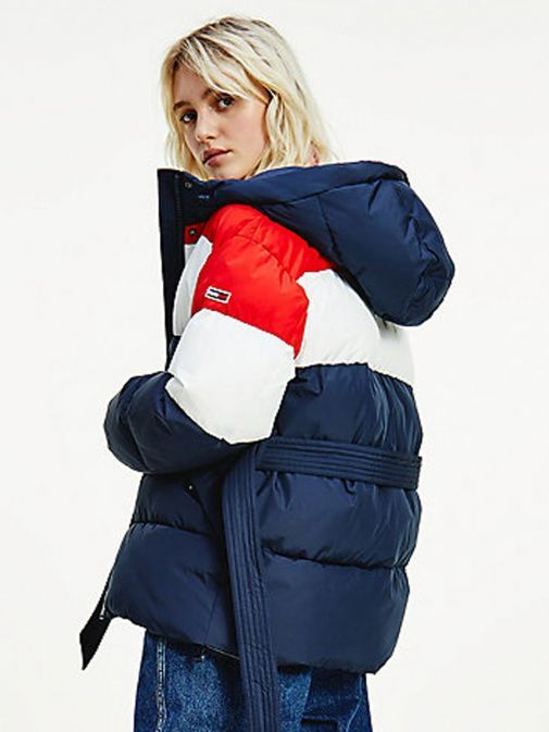 Back shot of model wearing Tommy Jeans Colour-Blocked Belted Down Puffer Jacket in Navy