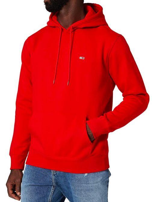 Model wearing Tommy Jeans Fleece Organic Hoody in Red