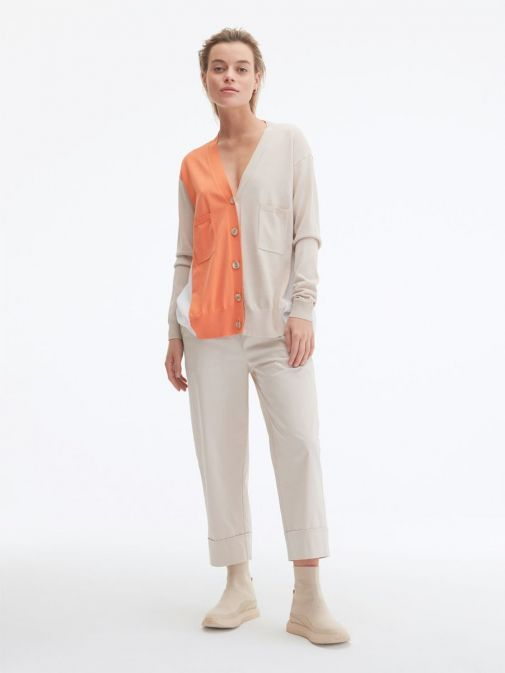 front shot of the Uchuu Contrast Panel Cardigan in Orange featuring pockets, button fastening and long sleeves