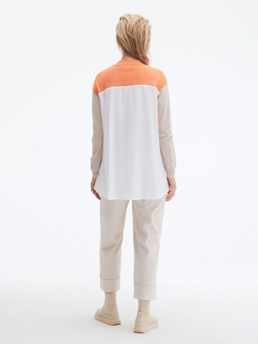 back shot of the Uchuu Contrast Panel Cardigan in Orange featuring pockets, button fastening and long sleeves