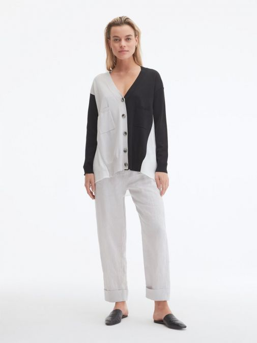 Front shot of the Uchuu Contrast Panel Cardigan in the Silver colour featuring pockets, long sleeves and button fastening