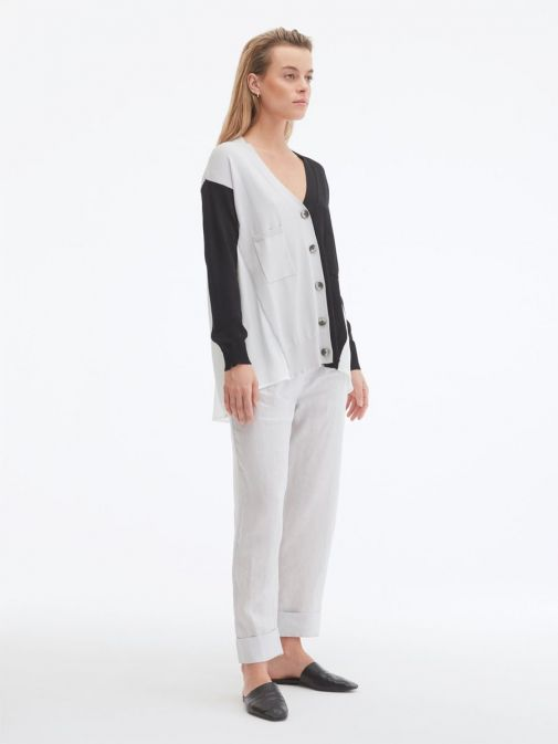 side shot of the Uchuu Contrast Panel Cardigan in the Silver colour featuring pockets, long sleeves and button fastening