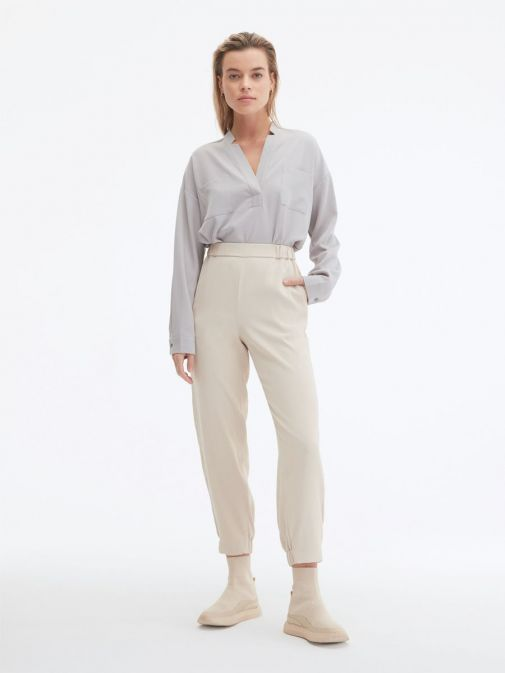 Front shot of the Uchuu Elastic Waisted Trousers in the Beige featuring pockets, elasticated waistband and ankle cuffs