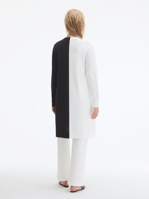back shot of the Uchuu Longline Cardigan in White and Black featuring pockets, long sleeves and contrasting block colours