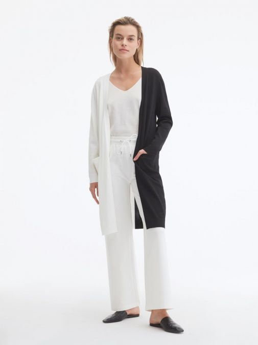 Front shot of the Uchuu Longline Cardigan in White and Black featuring pockets, long sleeves and contrasting block colours