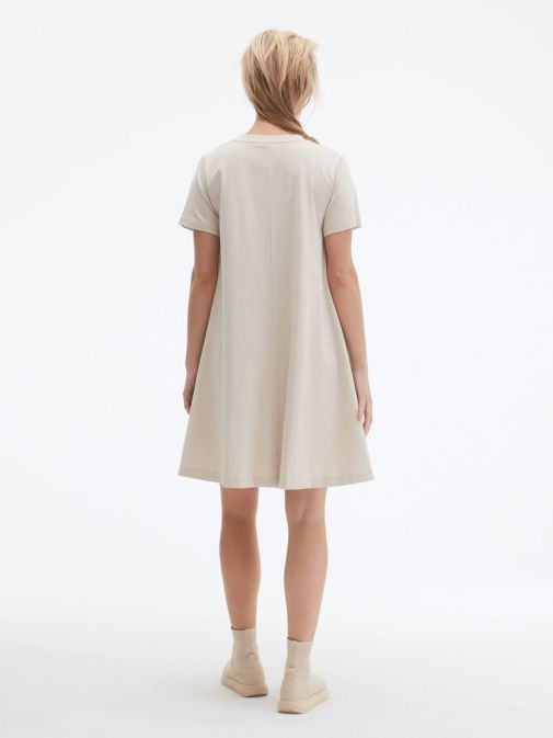 back shot of the Uchuu Round Neck Dress in the Beige colour featuring short sleeves and a rounded neckline