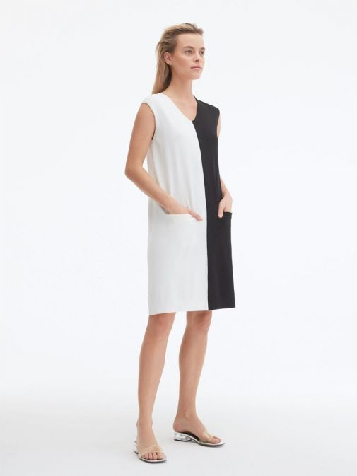 side shot of the Uchuu V-Neck Sleeveless Dress in the cream and Black colour featuring colour block pattern and two front pockets