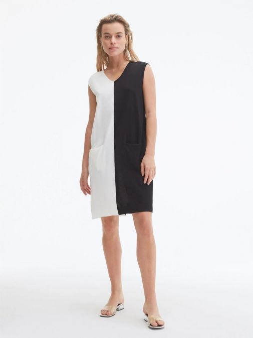 Front shot of the Uchuu V-Neck Sleeveless Dress in the cream and Black colour featuring colour block pattern and two front pockets