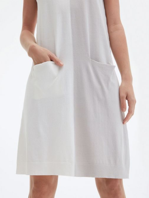 closeup shot of the Uchuu V-Neck Sleeveless Dress in the cream and grey colour featuring colour block pattern and two front pockets
