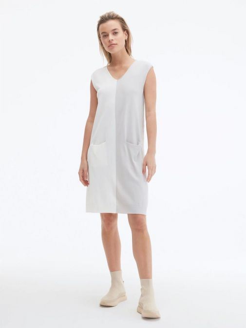 Front shot of the Uchuu V-Neck Sleeveless Dress in the cream and grey colour featuring colour block pattern and two front pockets