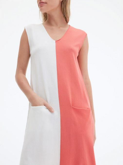 closeup shot of the Uchuu V-Neck Sleeveless Dress in the cream and Black colour featuring colour block pattern and two front pockets