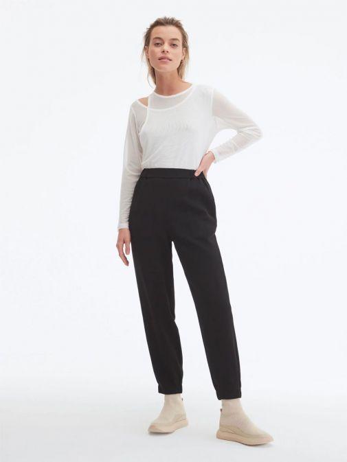 Model wearing Uchuu Elastic Waisted Trousers in Black