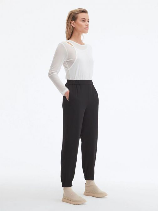 Side shot of model wearing Uchuu Elastic Waisted Trousers in Black