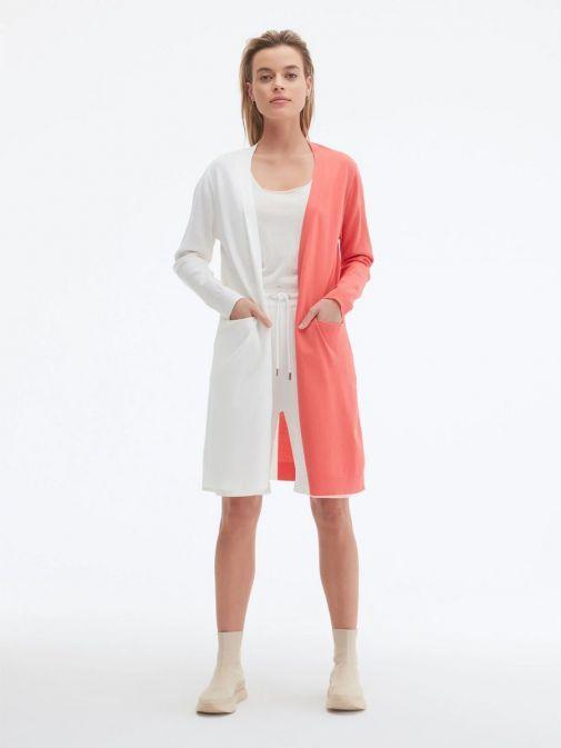 Model wearing Uchuu Longline Cardigan in White and Strawberry