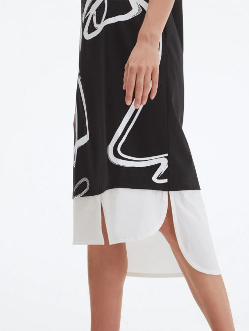 Close up of model wearing Uchuu Round Neck Printed Dress in Black