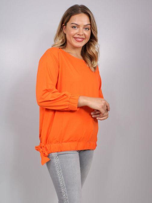 Model wearing Uchuu Tie Hem Top in Orange