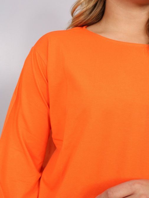 Close up of model wearing Uchuu Tie Hem Top in Orange