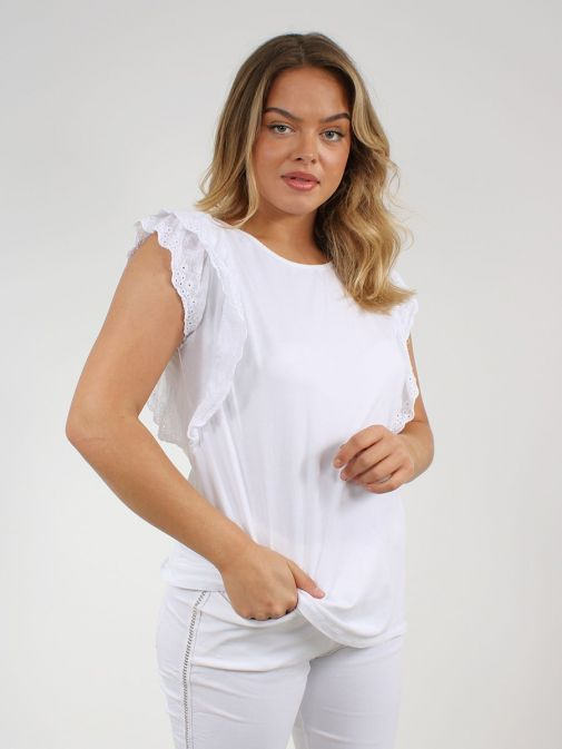 Front shot of the Cilento Woman Broderie Frill Sleeve Top in the White colour featuring rounded neckline and frill sleeve detailing
