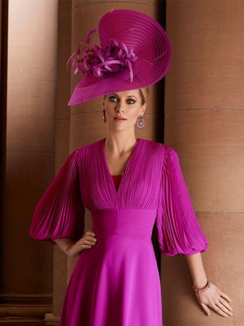 Close up of model wearing Veni Infantino for Ronald Joyce Chiffon Fit and Flare Dress, Magenta Pink, Style 29651