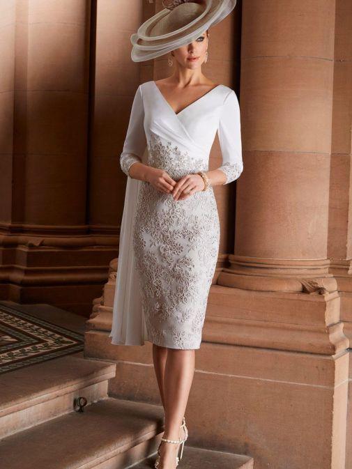 Model wearing Veni Infantino for Ronald Joyce Shoulder Drape Lace Dress, Ivory Platinum, Style 991823