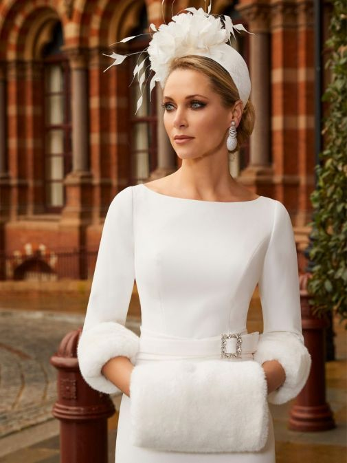 Close up of model wearing Veni Infantino for Ronald Joyce Bateau Neckline Dress with Faux Fur in Ivory, Style 991810, showing dress with faux fur collar removed