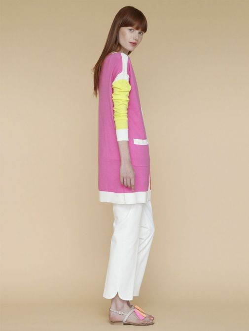 full outfit shot of the Vilagallo Ornella KN Trouser in the White colour featuring rounded hem to the bottom of each leg