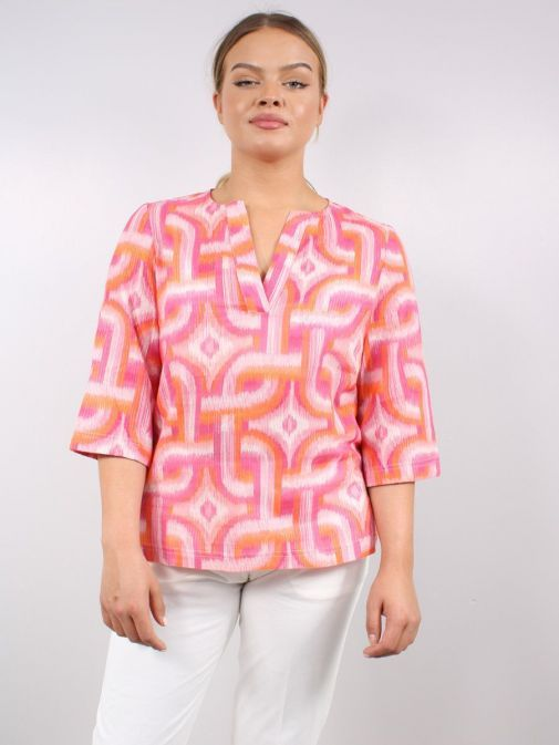 Model wearing the Vilagallo Analissa Kon Tiky Blouse in the Pink colour featuring rounded neckline with the v-neck feature, 3/4 length sleeves and elasticated cuffs
