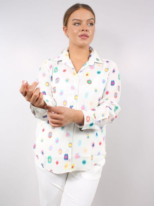 Model wearing the Vilagallo Gaby Atuona Shirt in the Cream colour featuring coloured pattern throughout, long sleeves, shirt collar, and button fastening
