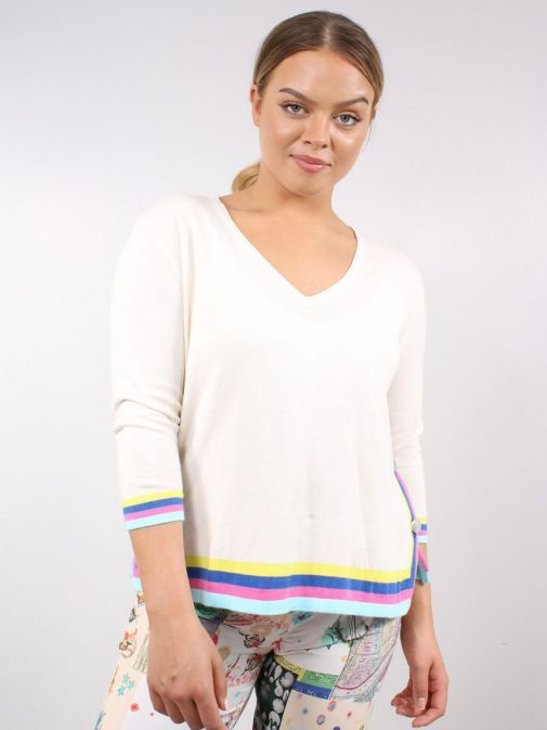 Model wearing Vilagallo Knitted Lavinia Sweater  in Cream that features a v-neck and multi stripes along hem and sleeves in yellow, blue, pink and light blue